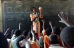 Rebecca Mwanyonyo, 35yrs, teaches a group of standard one pupils at the Gahaleni Primary School.
