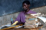 Randu Nzai, 42yrs, marks books during his class of standard two students at the Kadzuhoni Primary School. Nzai,married with 8 children, started school at the age of 13yrs due to his family being too poor to be able to afford his education. He teaches a class of 128 students and is a very dynamic.