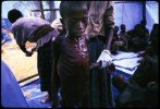A young starving boy is tended to at a UNICEF feeding centre. Zaire. July 1994.