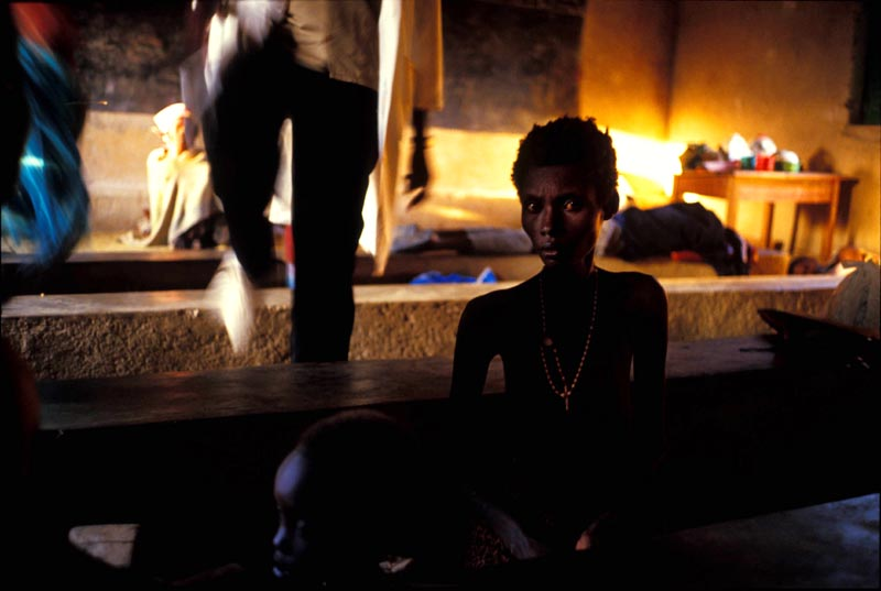 A Tutsi woman in hiding in a church during the Rwandan genocide. People were to scared to leave the compound to forage for food that they starved.
