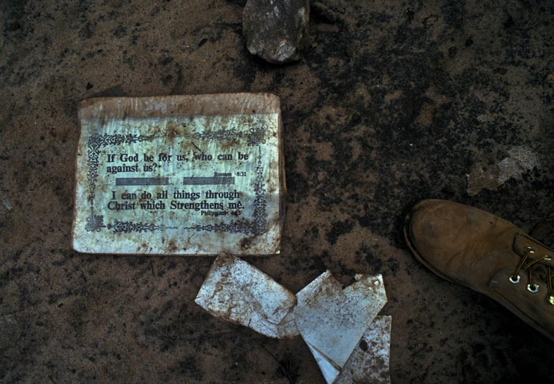 On the floor of a church where  many people had been massacred. Rwanda, May 1994.