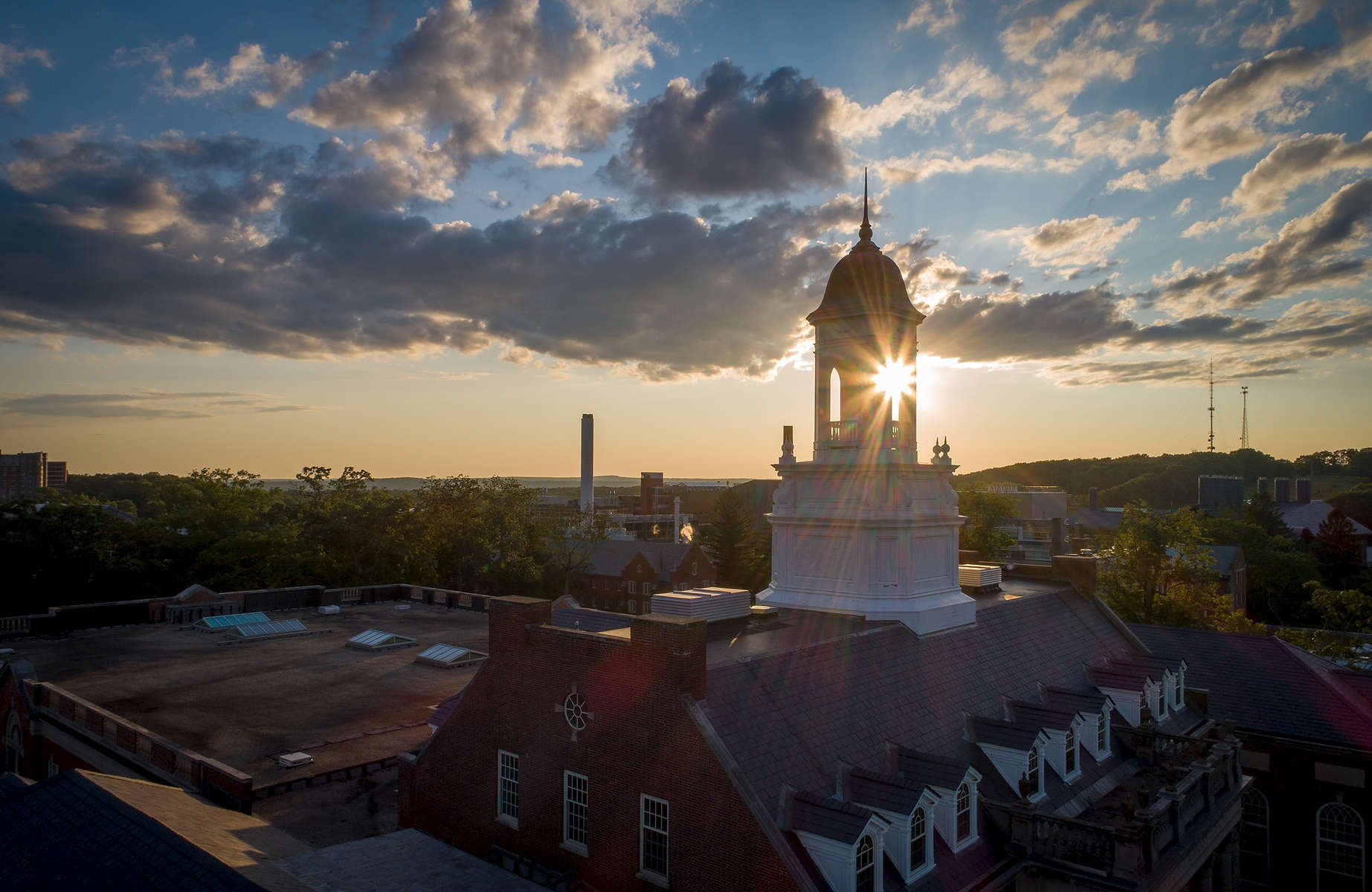 Sun sets behind Wilbur Cross Wednesday, July 24, 2019 in Storrs.
