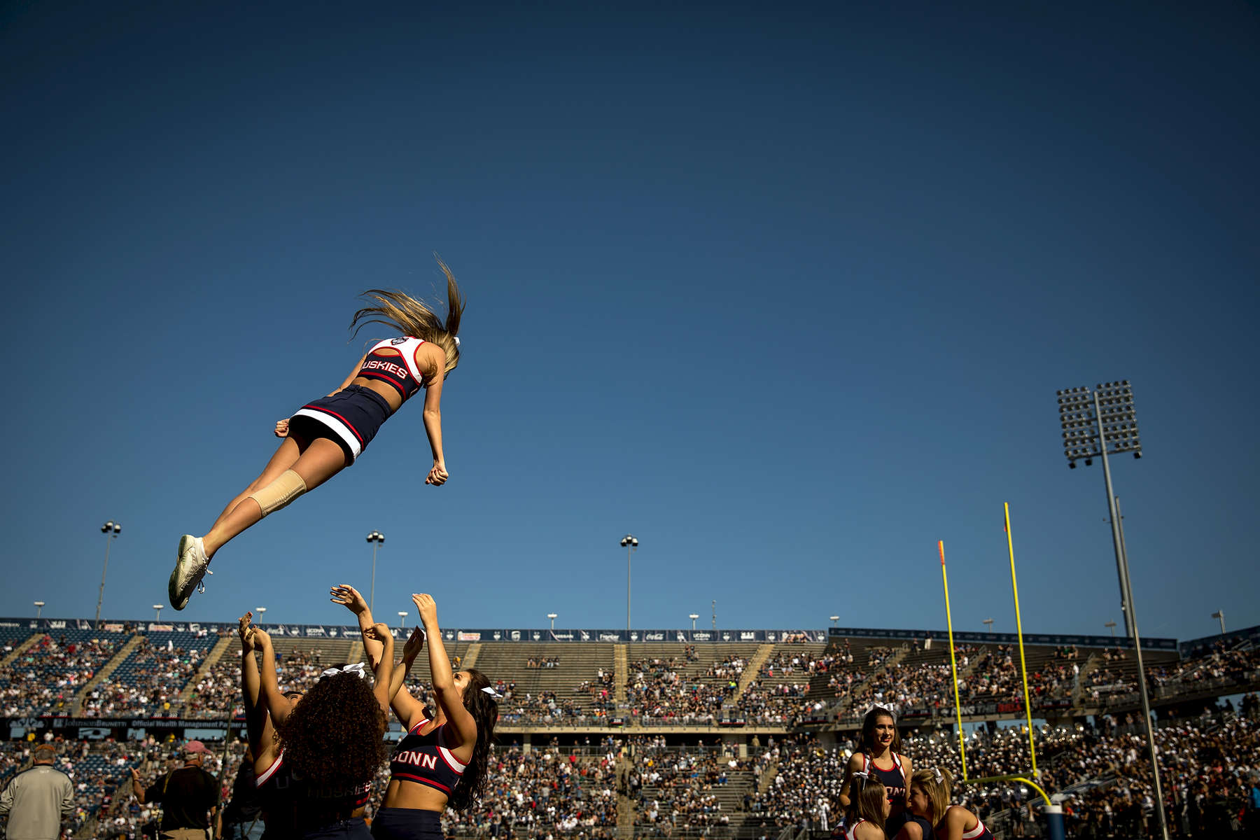 Cheerleaders perform during the UConn Huskies homecoming game against Tulsa Saturday, October 21, 2017 at Rentschler Field in East Hartford.