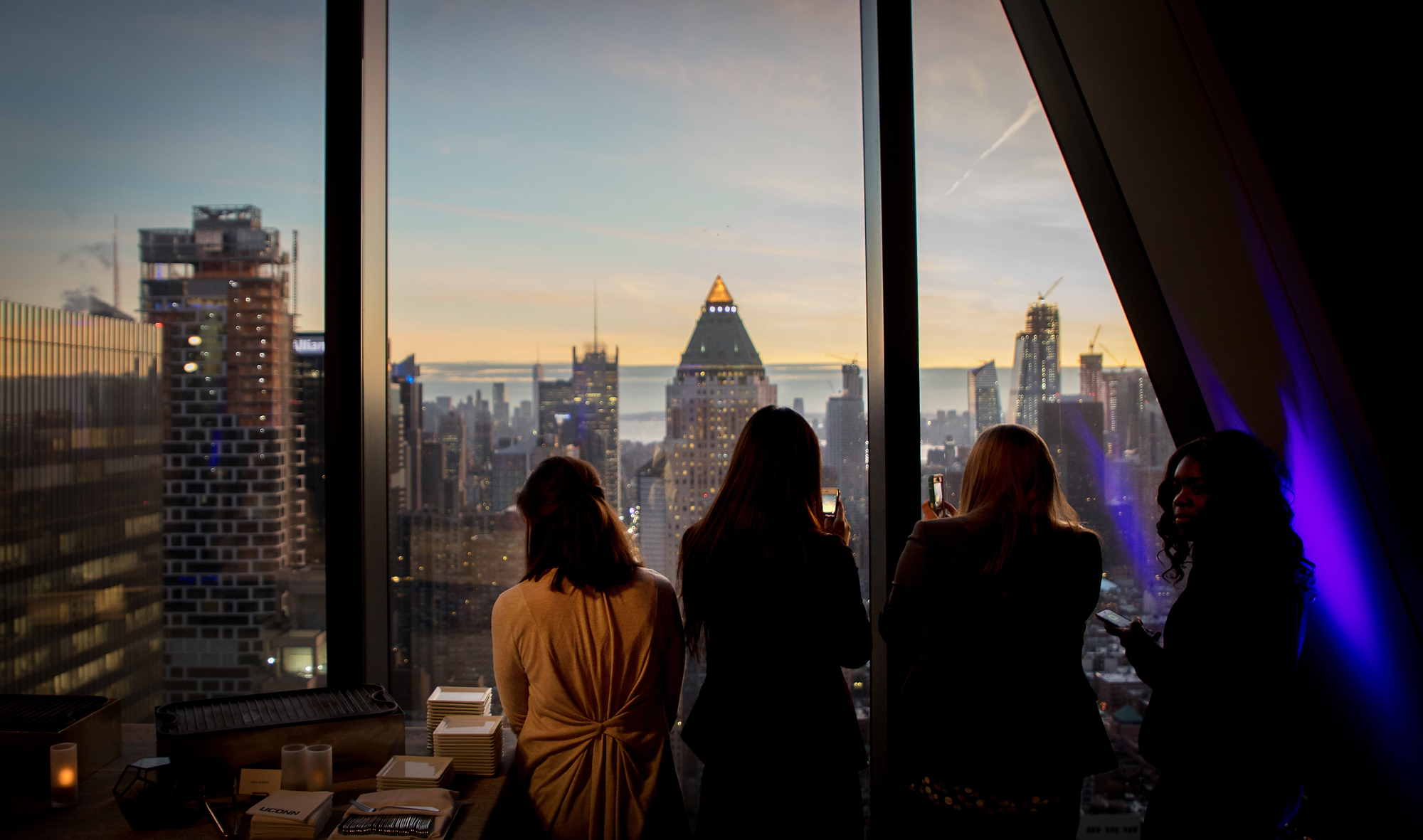 Students snap photos of the Manhattan skyline before the second annual Celebration of Scholarships event Tuesday, February 13, 2018 at Hearst Tower in New York City, New York.