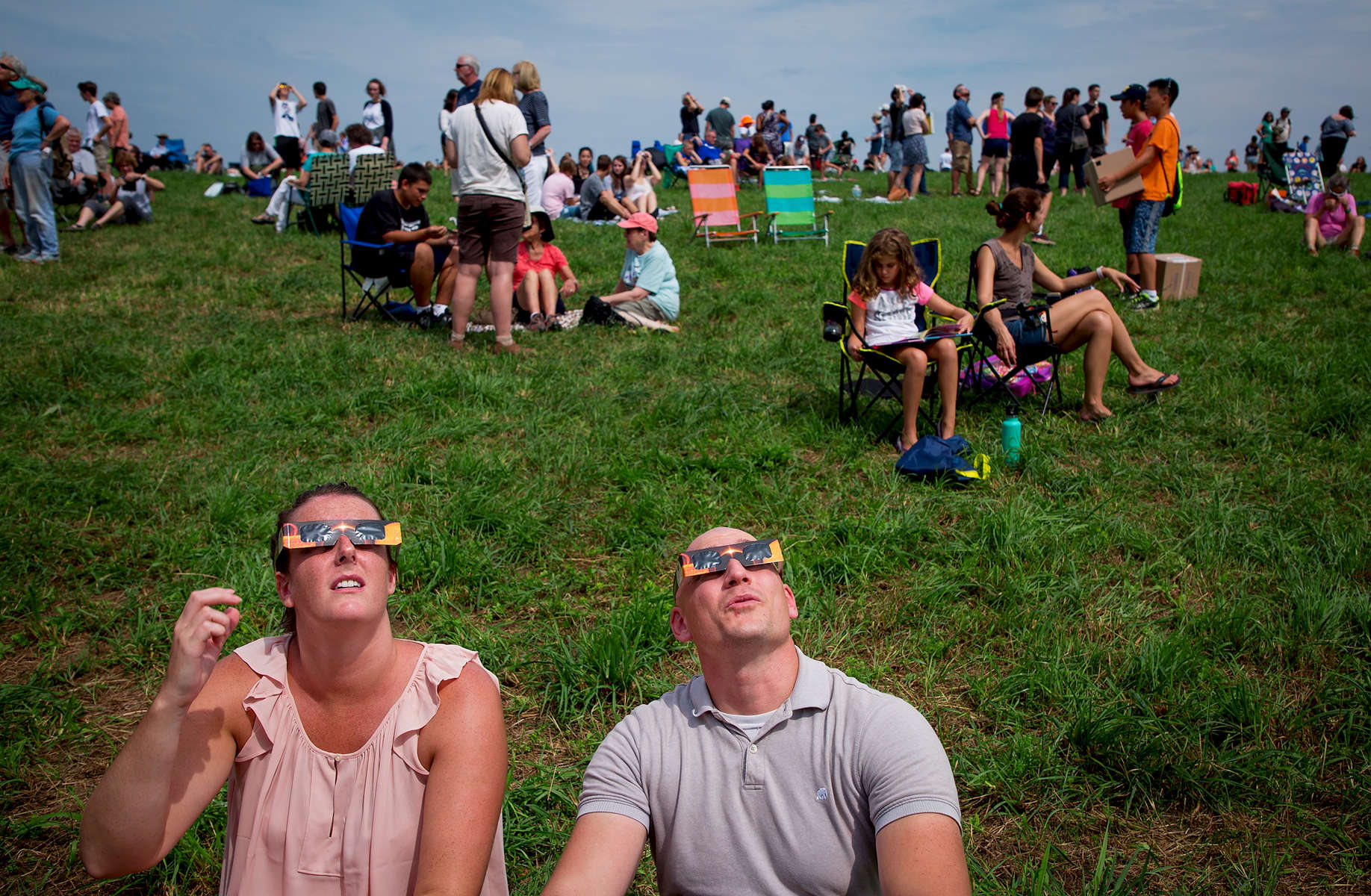 People watch a solar eclipse on Horsebarn Hill on the UConn campus Monday, August 21, 2017 in Storrs. (G.J. McCarthy / UConn Foundation)
