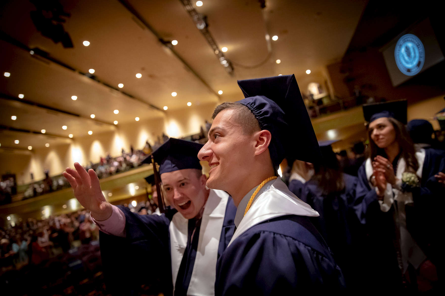 Students wave during the Spring Commencement ceremony for the UConn School of Fine Arts Saturday, May 11, 2019 at the Jorgensen Center for the Performing Arts in Storrs.