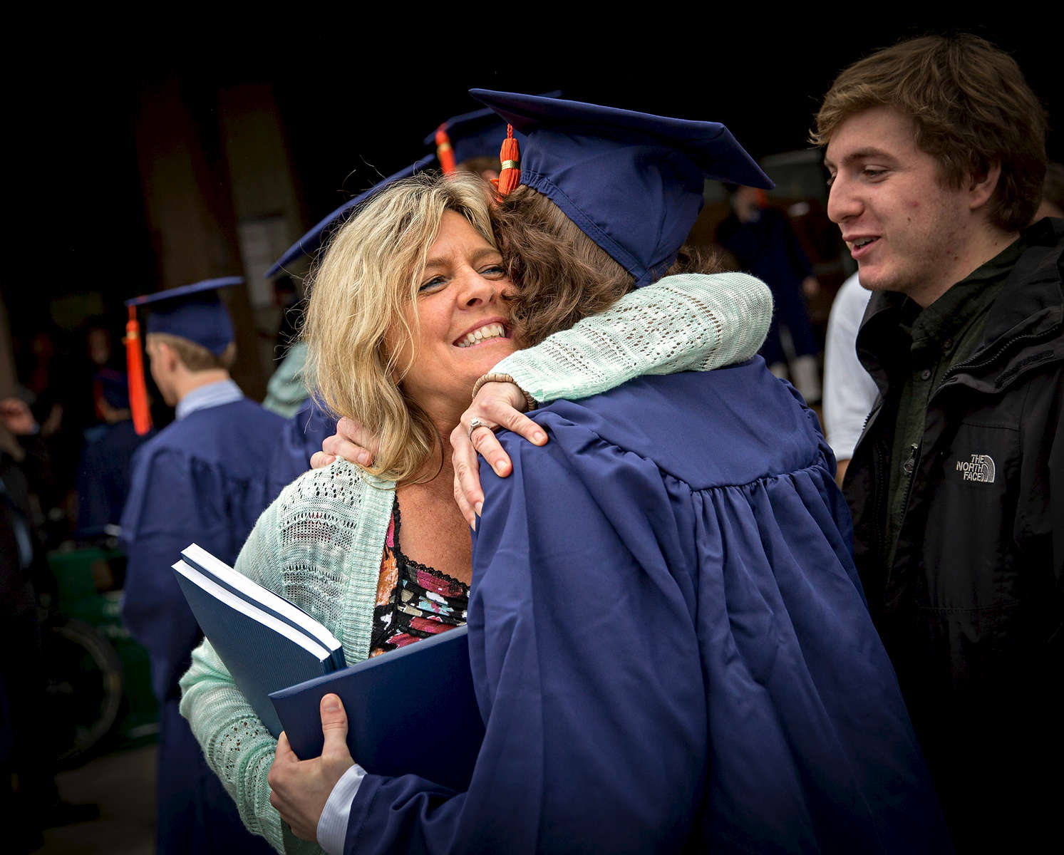 Families embrace following the UConn School of Engineering Commencement Saturday, May 6, 2017 at the Harry A. Gampel Pavilion in Storrs.