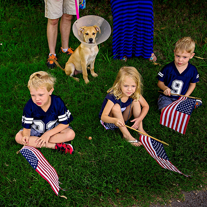 <p>(From left) Ray Hoffman, and siblings Luke Silvers, Marylee Silvers and Jack Silvers watch a parade go by during the Little Forest Hills 4th of July Celebration Friday, July 4, 2014 in Dallas. In its 12th year, the event drew scores of people from the east Dallas neighborhood and featured a parade, music and food. (G.J. McCarthy/The Dallas Morning News)</p>
