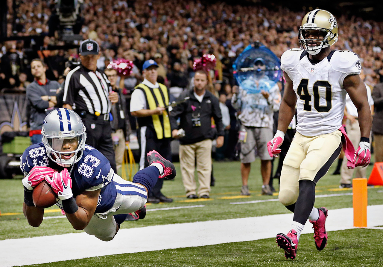 Dallas Cowboys wide receiver Terrance Williams (83) dives ahead of New Orleans Saints cornerback Delvin Breaux to score a touchdown during the second half of the Cowboys' 26-20 loss Sunday, October 4, 2015 at the Mercedes-Benz Superdome in New Orleans, La. (G.J. McCarthy/The Dallas Morning News)