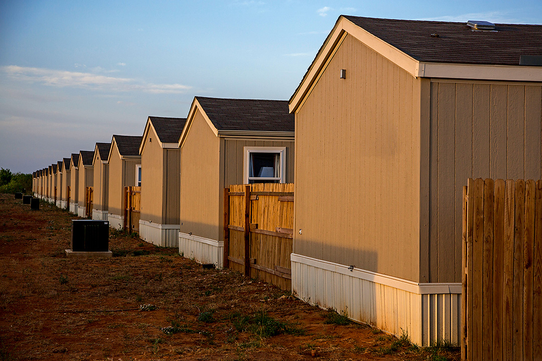 Rows of new units make up a {quote}man camp{quote} in this image taken Tuesday, May 6, 2014 in Cotulla, Texas. The camps, which are found all across the south Texas region, house transient oil and gas workers who have come to the area to work the Eagle Ford Shale.