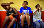 (From left) Broderick Brown winces with brain freeze while Brandon Little-Tullos laughs as they enjoy ice cream with Tykeydrick Askew during an ''Ice Cream Social'' at the   Family Gateway Center in Dallas. The event was held for about 50 homeless children who returned to the center from a summer camp in Branson, Missouri.