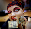 Sandra {quote}BZ{quote} of The Captain's Sideshow has cash stapled to her face as a tip after performing during the Immersed In Ink Tattoo Arts & Horror Festival in Mesquite, Texas.