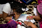 Ken'Tajiah Davis (left) grows frustrated as she goes over homework with her mother, Janice Hensley, in their room at the Dallas Life Foundation Wednesday, March 18, 2015 in Dallas. Hensley, her husband Kenneth Davis and three of their children have been living at the homeless shelter since April 2014. Ken'Tajiah, 11, suffers from stress-induced stomach problems and has trouble in school.