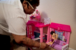 {quote}I want my babies to feel like this is their home, says Janice Hensley as she arranges her daughters' dolls in the room of their new apartment Tuesday, April 28, 2015 in northeast Dallas. Hensley, her husband Kenneth Davis and three of their children have been living at the Dallas Life Foundation homeless shelter since April 2014. Through the help of Family Gateway, the were able to secure their first apartment since becoming homeless.
