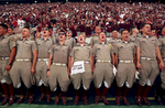 Texas A&M Corps of Cadets members lead fans in a yell before the Aggies' 49-42 loss to Alabama at Kyle Field in College Station, Texas.