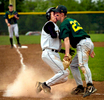Fulton's Ryan Back collides with Rock Bridge's Brandon Gerau as he scores a run during the third inning in Columbia.