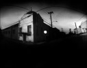 Abandoned building off South Lamar in Dallas, taken on March 6, 2009 with tin can camera. Two minute, 15 second exposure on RC photo paper.