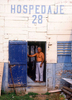Don Pedro, the owner of the Hospedaje #28 guest house in San Juan del Sur, Nicaragua, poses at the back door of his establishment in June of 1995.