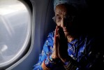 Radika s Baptem. Radika Mainali, in a plane for the first time in her life, praying before they take off.