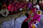 Women from the Gulabi Gang listening to Sampat Pal Devi during a meeting in Attara.