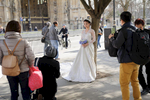 A wedding party encountered opposite the Houses of Parliament in Westminster.