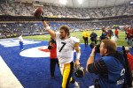 Indianapolis, Indiana. Quarterback Ben Roethlisberger salutes the thousands of Steelers faithful that witness a thrilling 21-18 playoff victory that was saved by Roethlisberger's shoe-string tackle of Indianapolis Colts Nick Harper late in the Fourth Quarter at the RCA Dome./ Vincent Pugliese