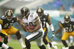 Jacksonville, Florida.     Jacksonville Jaguars running back Fred Taylor tries to avoid a group of Pittsburgh Steelers defenders during a heavy thunderstorm at Alltel Stadium in Jacksonville, Florida on September 9th, 2001./ Vincent Pugliese