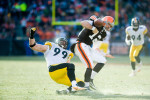 Cleveland, Ohio.   Pittsburgh Steelers linebacker Brett Keisel strips quarterback Colt McCoy of the football during Pittsburgh's 41-9 blowout of the Browns at Cleveland Browns Stadium in Cleveland, Ohio./ Vincent Pugliese