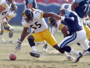 Nashville, Tennessee.   Pittsburgh Steelers linebacker Joey Porter strips Tennessee Titans quarterback Steve McNair of the football and recovers the fumble during their game at Adelphia Coliseum in 2001. / Vincent Pugliese
