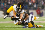 Baltimore, MD.     Pittsburgh Steelers defenders Tryo Polamalu (43) and James Harrison (92) team up to drop Baltimore Ravens running back Ray Rice for a loss during their game at M & T Bank Stadium on December 2nd, 2012.