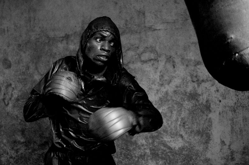 Youth group member Ndumba boxes at a gym in the slum.