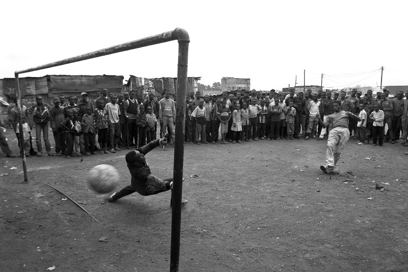 Kepha takes a penalty kick during a local soccer tournament.