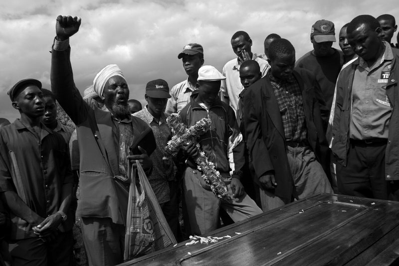 A preacher prays over the coffin of a young Mathare Valley man shot by police while robbing a grocery store in a neighborhood bordering the slum.Petty crime got so out of control during 2005 that the police were ordered to operate on a shoot-to-kill basis.