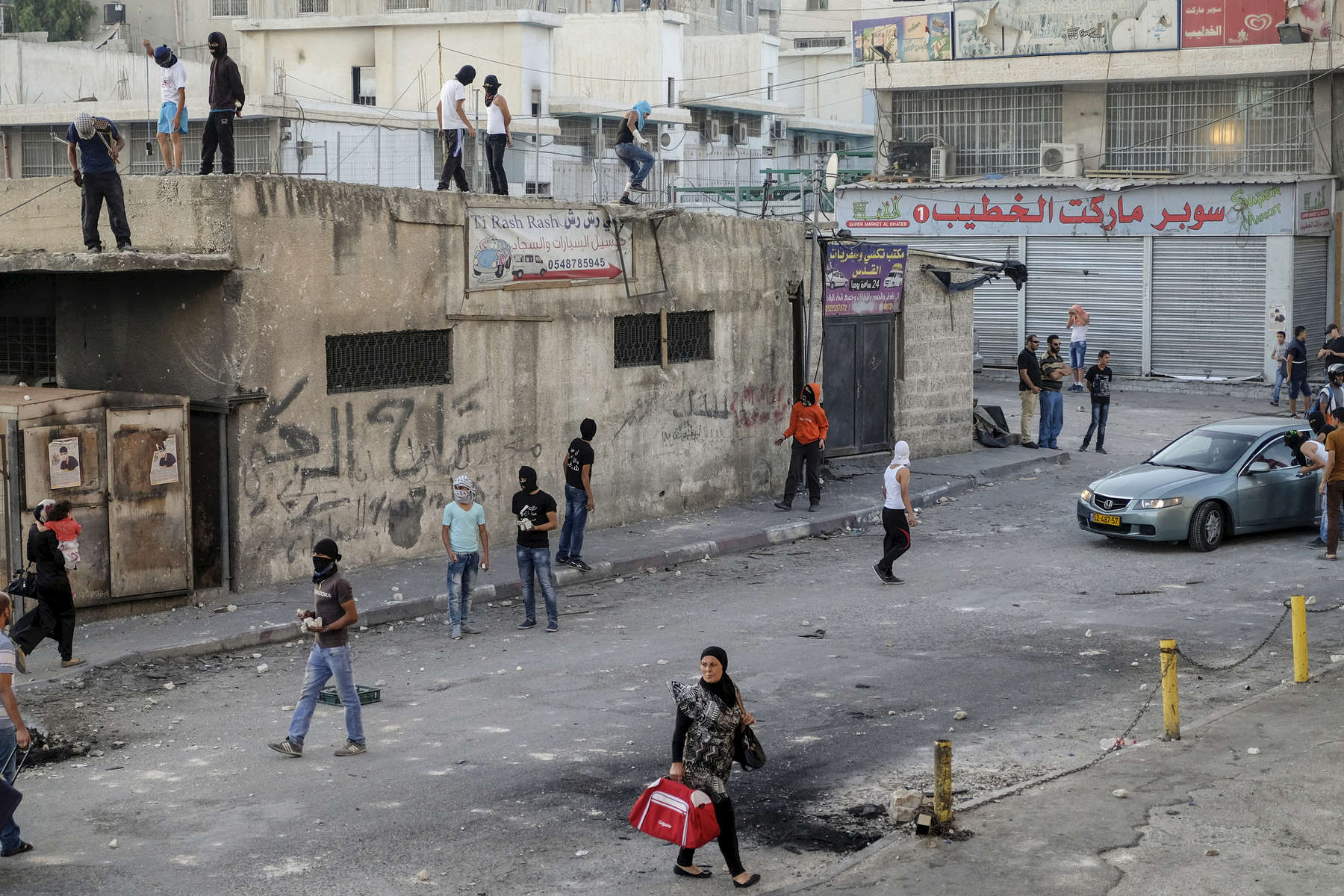 2014. Jerusalem.  Israel. Shuafat Refugee Camp in East Jerusalem during clashes between Palestinian youths and Israeli border police.  Although ostensibly the clash was in solidarity with the Gazans under siege in Operation Protective Edge, the clashes are also a near daily occurrence.