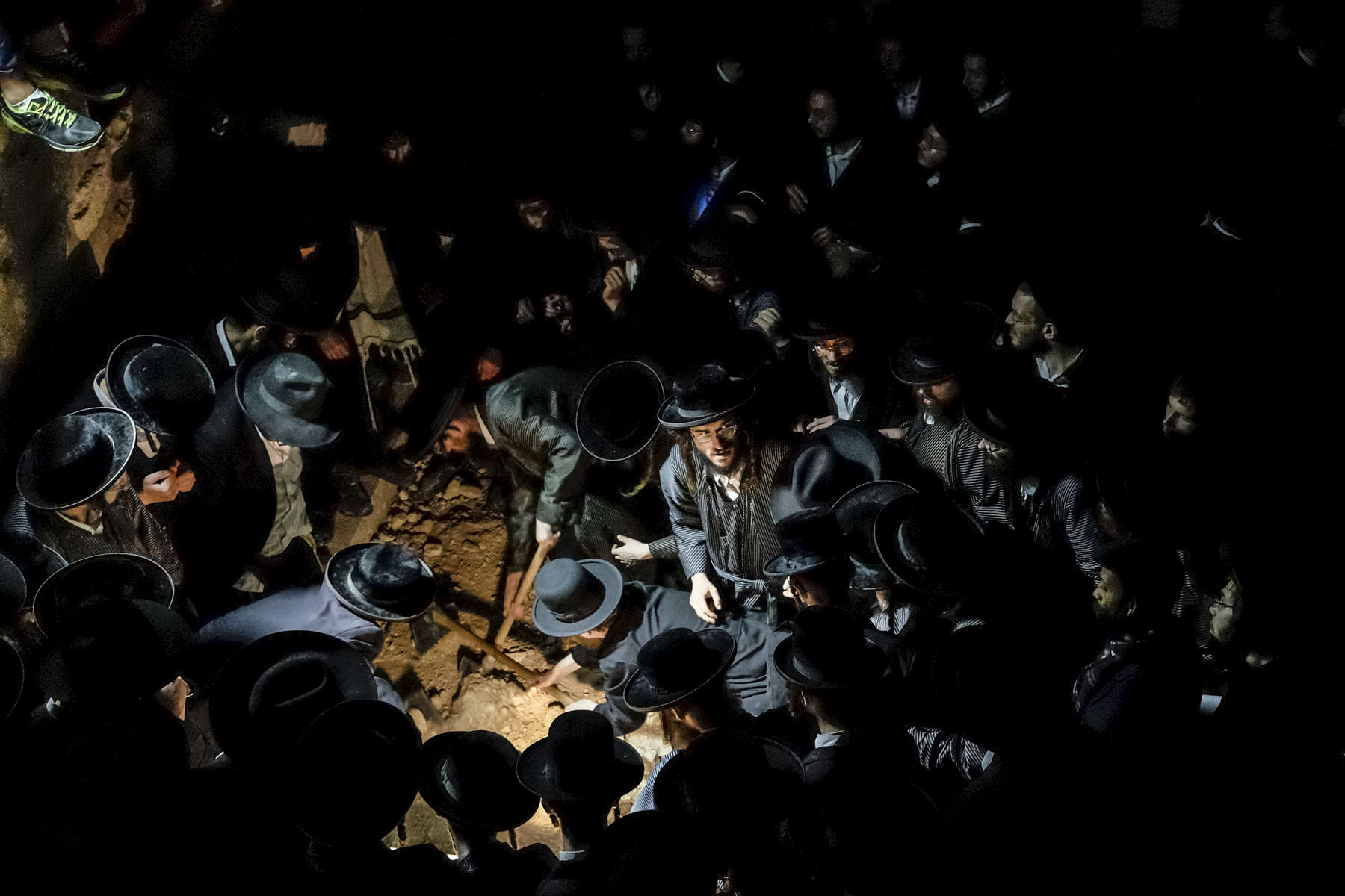 2014.  Jerusalem.  Israel. The funeral of Avraham Walz, 29, killed in an attack earlier that day by a Palestinian in a stolen digger.  Six Israelis were injured and the assailant, identified as Muhammed Naif el-Ja'abis.  Walz was a member of Toldos Aharon, a strongly Anti-Zionist Hasidic movement.