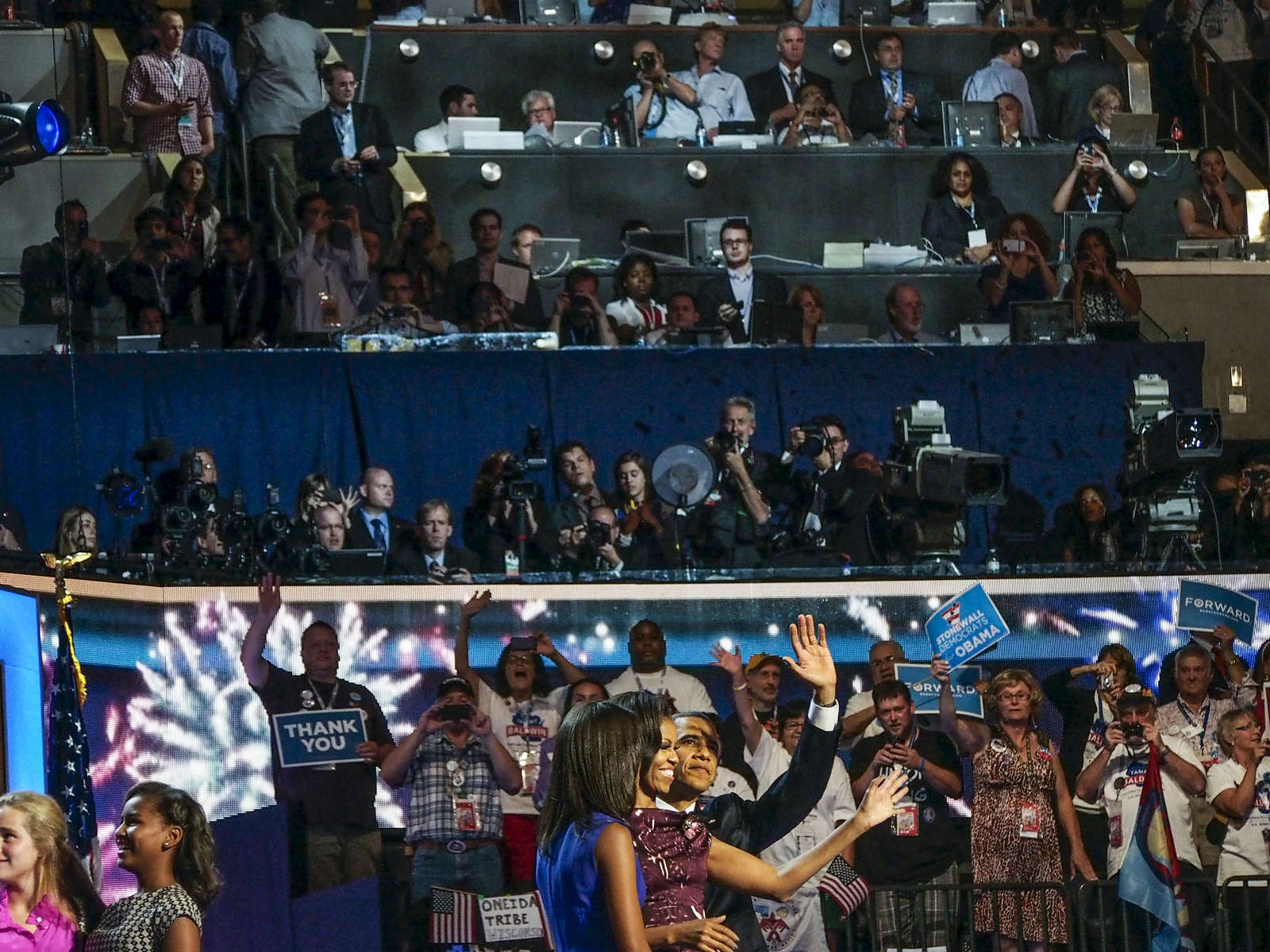 2012.  North Carolina.  USA. President Barack Obama with his wife Michelle and daughter Malia greet the crowd at the conclusion of the 2012 Democratic National Convention in Charlotte, North Carolina.
