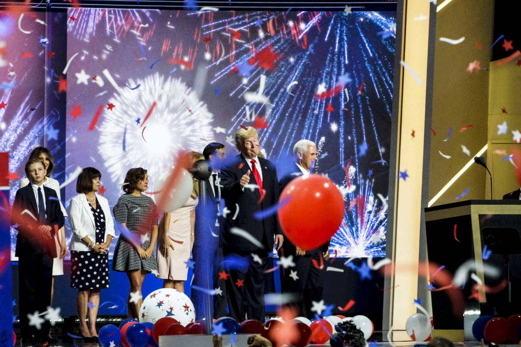 2016. Cleveland, Ohio. USA.  Trump, Pence and families wave to the crowd as balloons and confetti fall from the rafters to signal the end of the RNC at the Quicken Loans Arena.