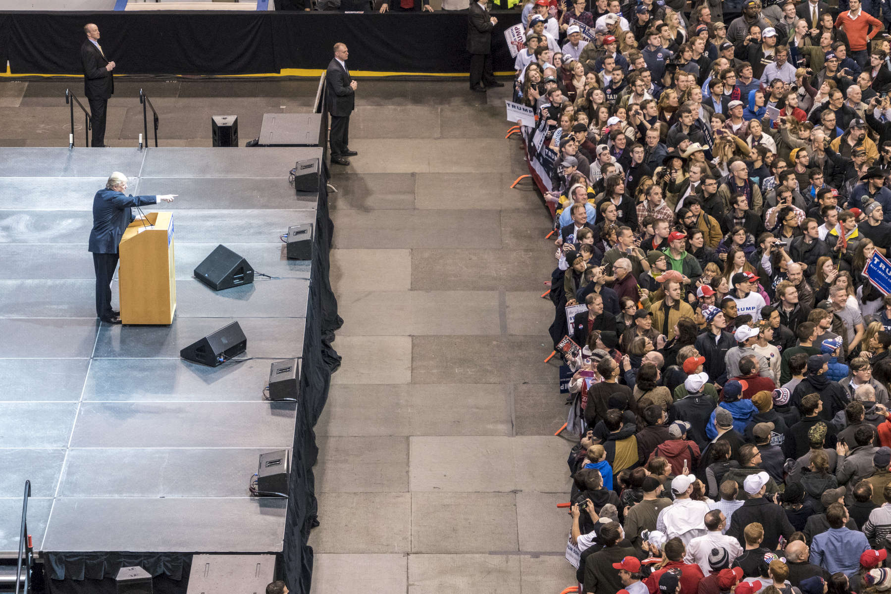 2016.  Manchester, NH.  USA.  Donald Trump addresses the crowd at a rally at Verizon Center on the eve of the primary. Donald Trump ultimately won the Republican primary and Bernie Sanders won the Democratic.