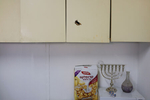 2013.  Hebron.  Palestinian Territories/The West Bank.  A bullet hole from the Second Intifada in the house of an Israeli settler in the middle of Hebron.