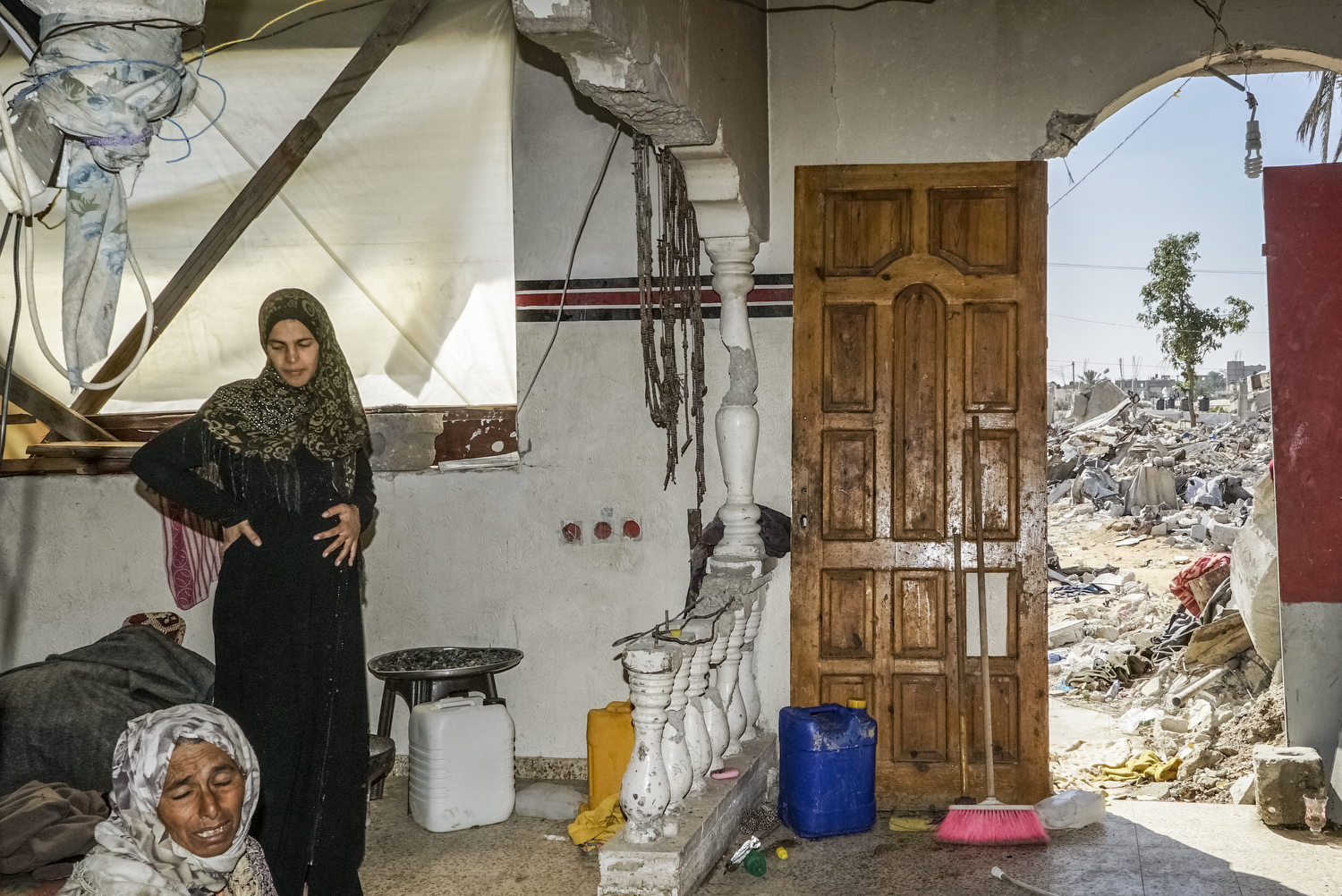 2014.  Gaza.  Palestine.The Najar family in their destroyed home.    Operation Protective Edge lasted from 8 July 2014 – 26 August 2014, killing 2,189 Palestinians of which 1,486 are believed to be civilians. 66 Israeli soldiers and 6 civilians were killed.  It's estimated that 4,564 rockets were fired at Israel by Palestinian militants.