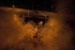 EGYPT.  Cairo.  2011. Mubarak supporters shrouded in smoke during all night classes by Tahrir Square.