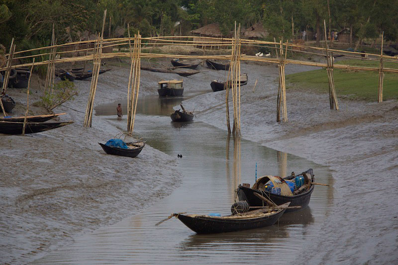 Scenes of the village of Chandpai on the Passur River, where shrimp fry (shrimp larvae) fishing to supply shrimp for the shrimp ponds is the main industry.  Villagers live in simple mud and thatch huts that are washed away by high waters every year.