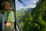 Ornithologist Bruce Beehler preforming an aerial survey of the Foja Mountains in a heliocopter.