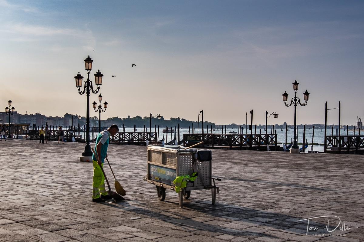 Street sweeper in St. Mark's Square in Venice, Italy