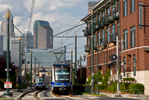 Charlotte's Lynx light rail with Charlotte Skyline in background
