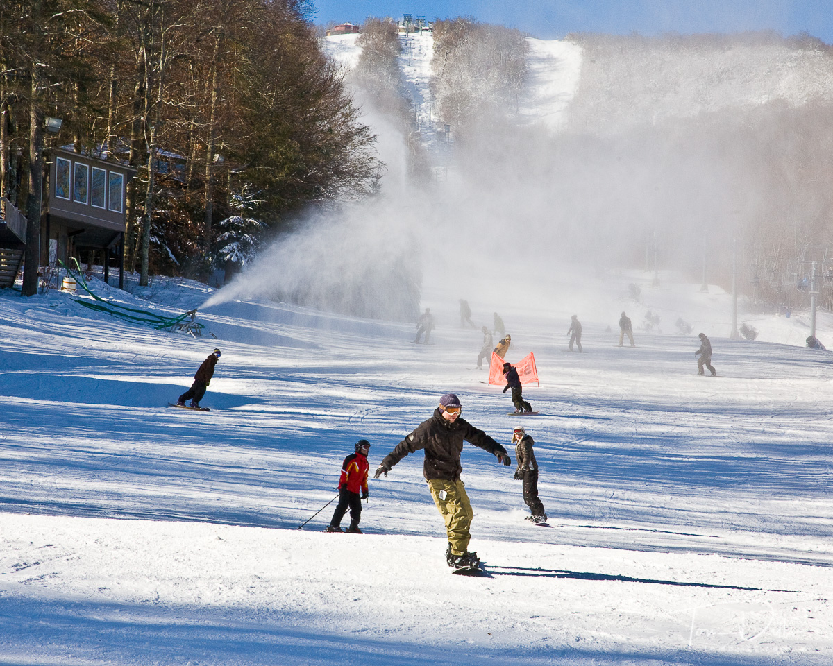 With a peak elevation of 5,300 feet, a vertical drop of 1,200 feet, a longest run of 1 1/2 miles and 115 skiable acres, Sugar Mountain Resort is the largest ski area in North Carolina.  Sugar Mountain Resort first opened in 1969 for skiers and has since expanded it's winter operation to include snowboarding, tubing, ice skating and snowshoeing.  Summer activities include Summer Lift Rides, hiking and biking and the Oktoberfest.   Our 20 slopes and trails are varied to accommodate our beginners with our Magic Carpet area, the experts with our double black diamond Whoopdedoo or anyone in between. Ski/Snowboard School programs are available for group, private or children's lessons andour Group Sales department handles groups of 15 or more.  Make plans to visit Sugar Mountain Resort this year with your friends and family. We look forward to seeing you!