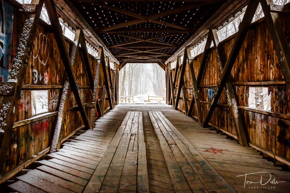 Kidd's Mill Covered Bridge, Reynolds, PA.  Built in 1868, spanning the Shenango River.  The only remaining bridge in Pennsylvania with an all-wooden truss design patented by Robert Smith of Tippecanoe City, Ohio.  The last historic covered bridge in Mercer County, extending 120 feet in length and restored in 1990.