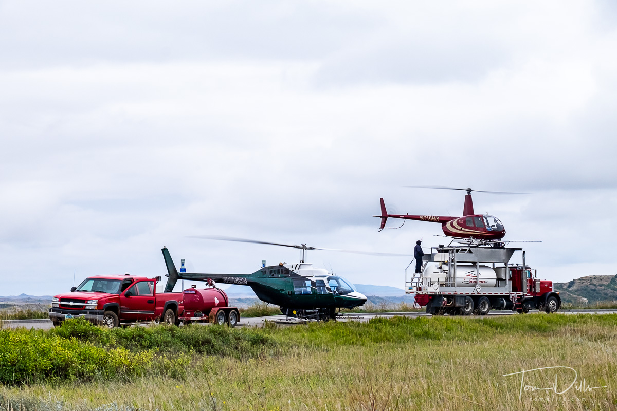 Helicopters preparing for aerial spraying at Theodore Roosevelt National Park, North Dakota
