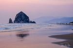 Haystack Rock at sunset over the Pacific Ocean from Cannon Beach, Oregon