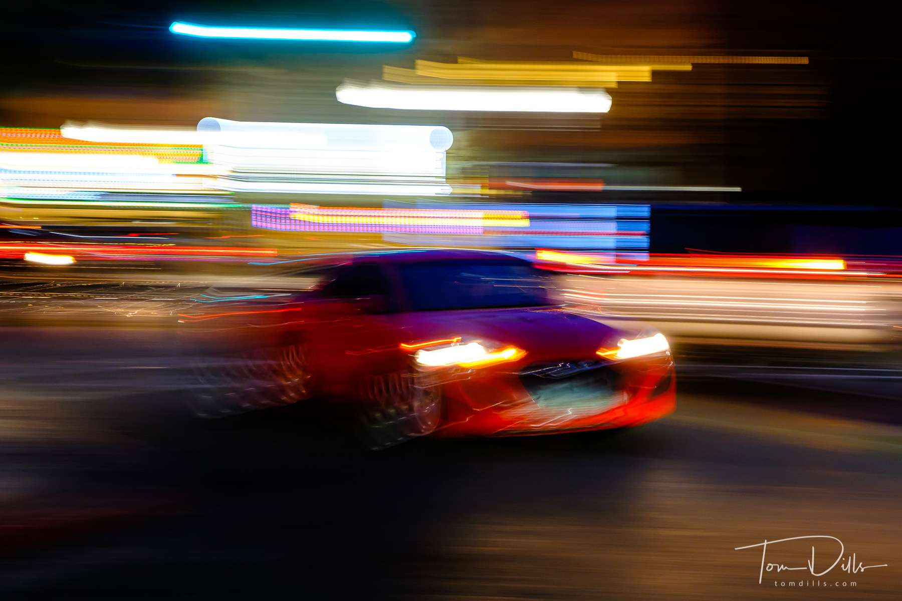 Motion blur of cars while waiting for dinner in downtown Ogden, Utah